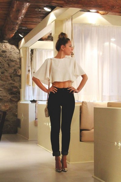 white bat top with black slim fit jeans with cuff