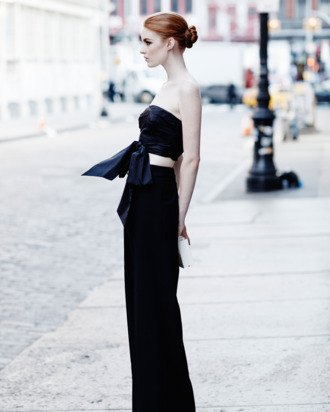 black, short, knotted top with wide-leg trousers