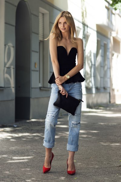 black strapless peplum top with deep v-neck and boyfriend jeans
