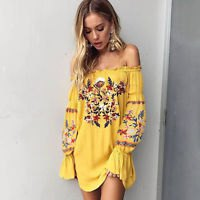 Mustard-yellow shirt dress with a floral print