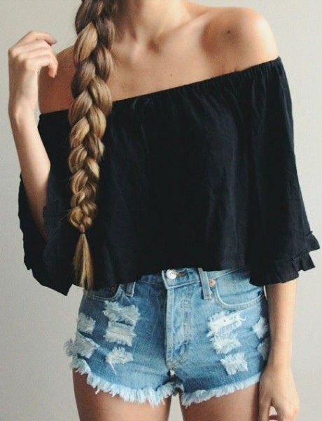 Black off shoulder shirt with half sleeves and blue shorts with a mini denim tear
