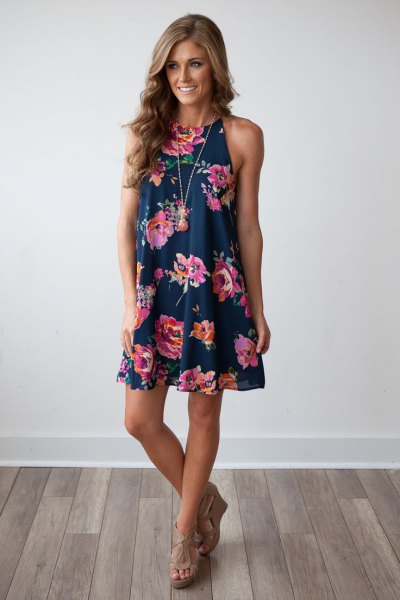 Navy swing mini swing dress with floral pattern and nude sandals