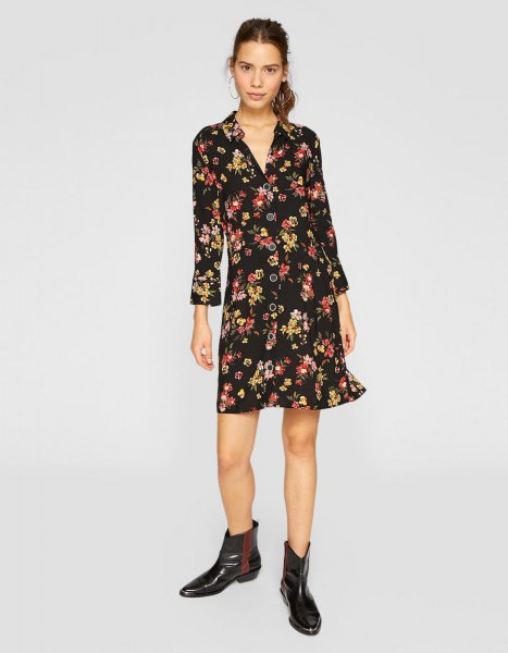 black mini long-sleeved dress with floral pattern and V-neck and leather boots