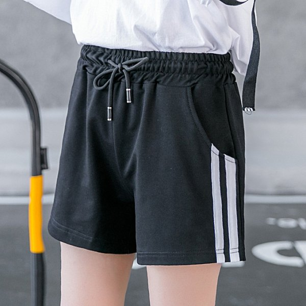 white long sleeve t-shirt with black running shorts