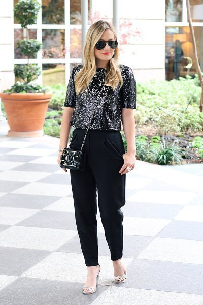 black sequin top with loosely cut dress pants