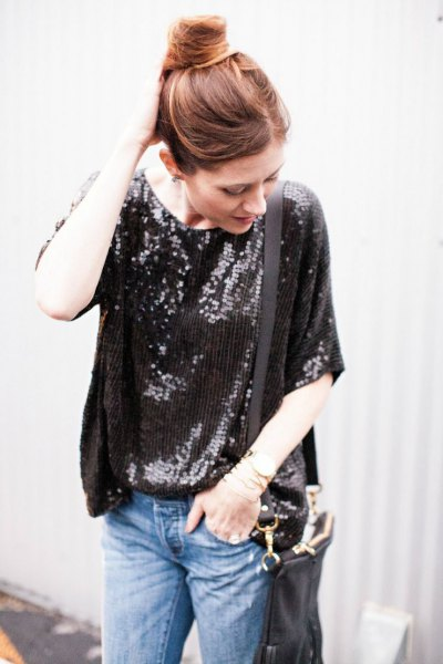 black oversized sequin t-shirt with blue slim fit jeans