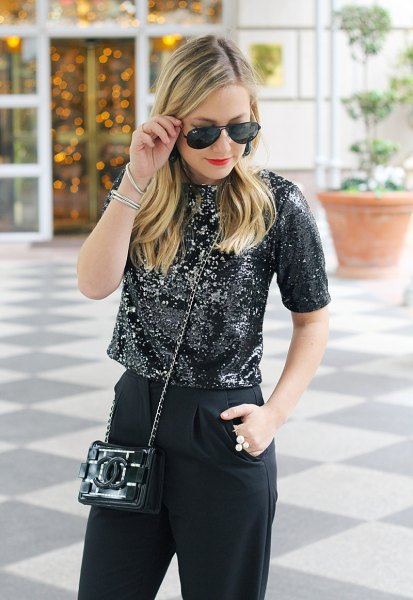 black, short cut sequin top with slim fit jeans