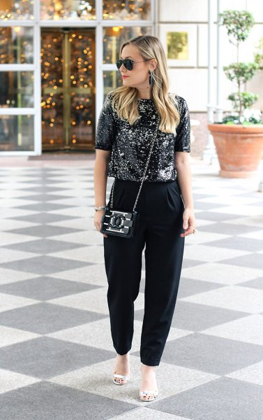 black sparkling top with matching chinos and white sandals