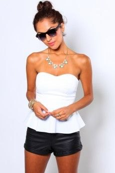 strapless top made of white peplum with black mini leather shorts