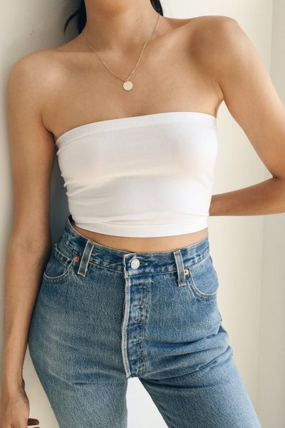 white short strapless top with blue skinny jeans