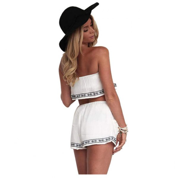 white strapless crop top with mini shorts in tribal style