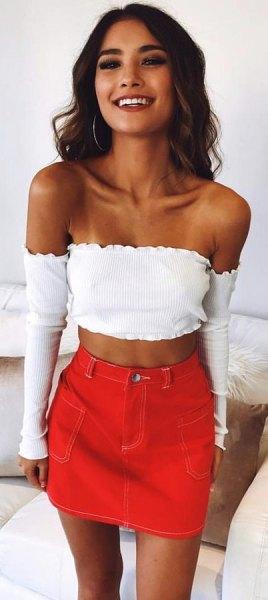 white long-sleeved strapless short blouse with orange mini skirt