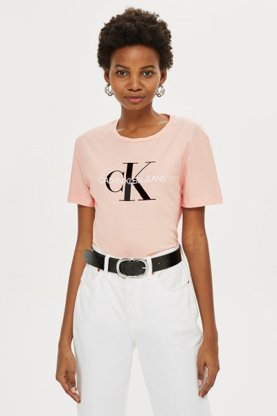 Light pink tailored graphic t-shirt with white straight leg jeans