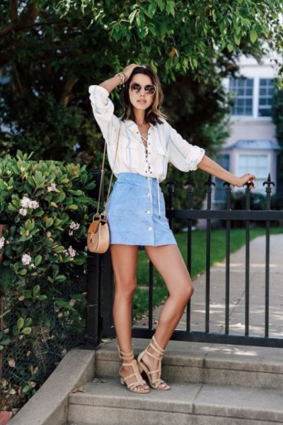 white lace shirt with light blue mini skirt with jeans button on the front