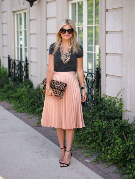 gray t-shirt with rose gold colored high rise pleated skirt