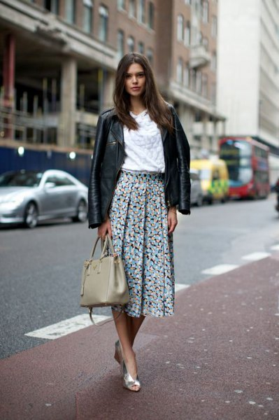 black leather jacket with white blouse and floral pleated skirt