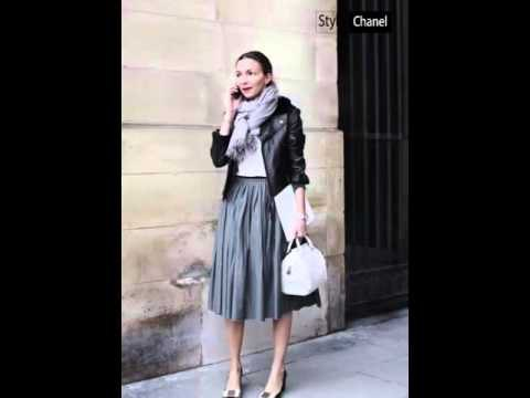 black leather jacket with gray midi skirt and fringed scarf