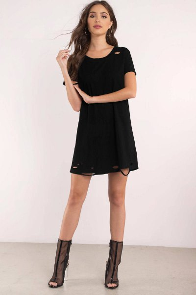 black t-shirt dress with semi-transparent boots in the middle of the calf