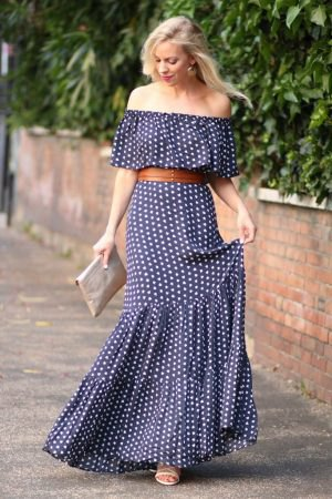Dark blue and white polka dots on the maxi dress with a shoulder belt
