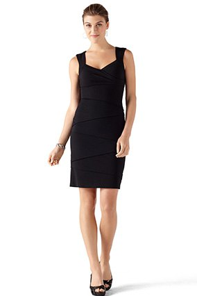 black sleeveless, form-fitting mini dress with V-neck and open toe heels