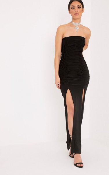 black strapless maxi dress with double slit and open toe heels with ankle straps