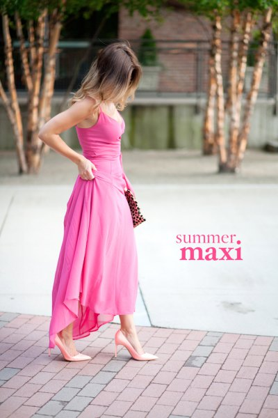pink maxi high low dress with heels and clutch with leopard print
