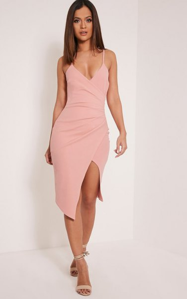 Light pink, form-fitting midi wrap dress with deep V-neck