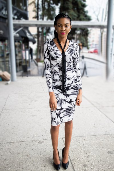 Black and white long sleeve wrap dress with floral pattern and tie