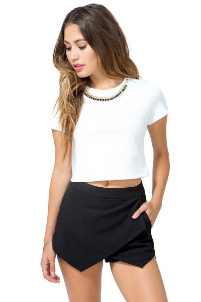 white short t-shirt with black mini skirt
