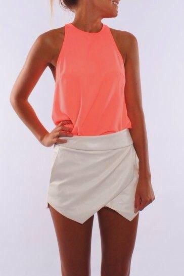 orange tank top with white mini silk turn-up skirt