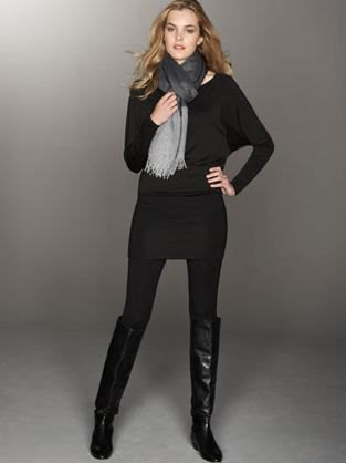 black sweater with leggings and knee-high boots
