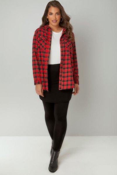 red and black checked shirt with leggings and short leather boots