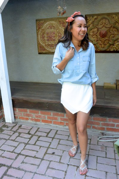 light blue shirt with buttons and white mini skirt