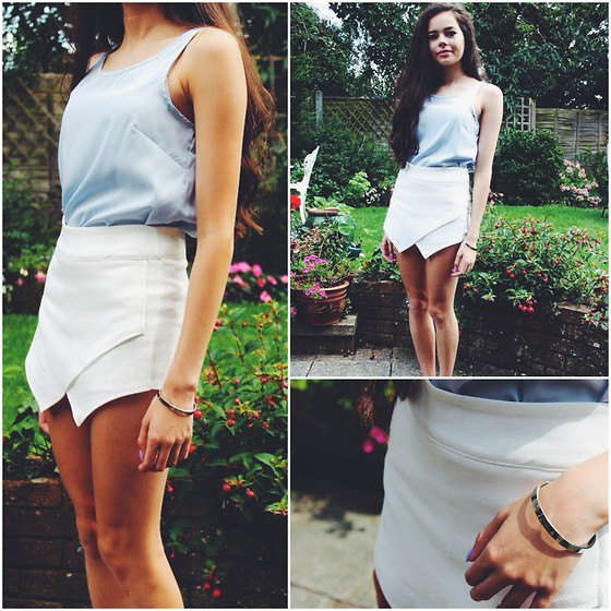 gray tank top with scoop neck and white mini skirt