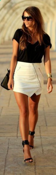 black t-shirt with white leather mini skirt and ankle strap heels