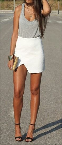 gray tank top with a scoop neckline and white high skirt mini skirt