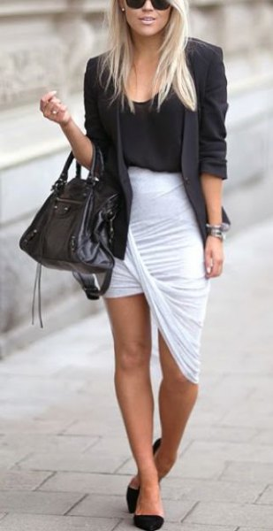 black blazer with matching tank top with a scoop neck and asymmetrical white flap skirt