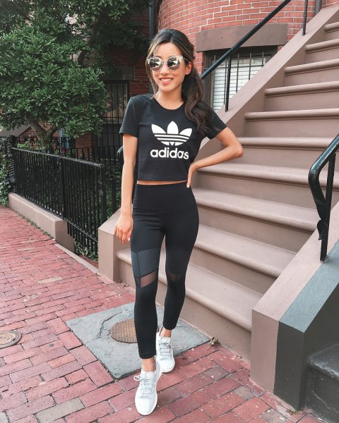 black short graphic t-shirt with mesh leggings and white sneakers