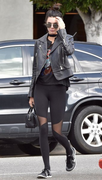 black leather jacket with graphic t-shirt and mesh gaiters