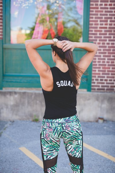 black graphic tank top with floral workout leggings