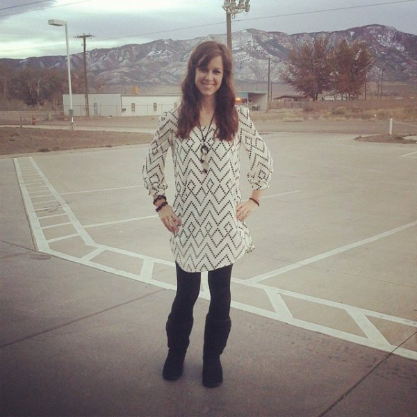 white and black printed tunic blouse with black fleece lined leggings and boots