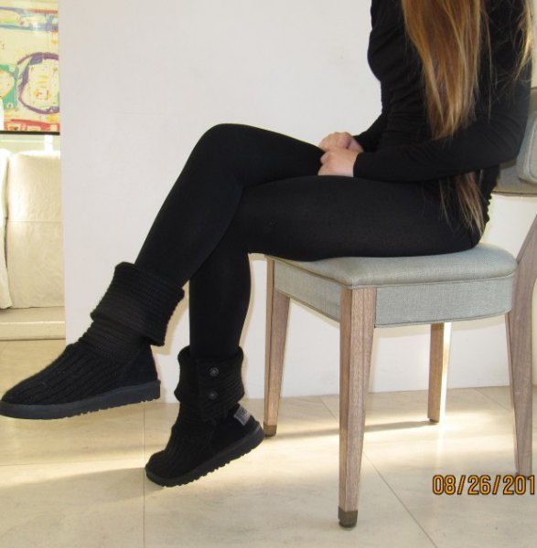 black figure-hugging sweater with matching boots in the middle of the calf