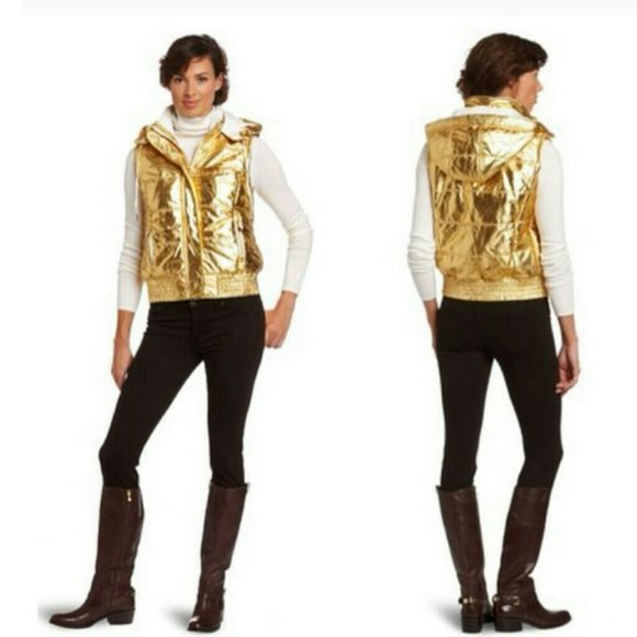 shiny gold hooded vest with white mock-neck long-sleeved T-shirt