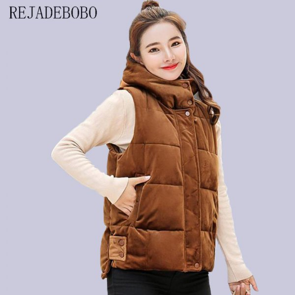 golden brown thick quilted vest with light pink sweater