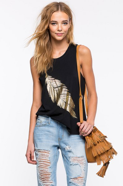 black and gold vest top with torn boyfriend jeans