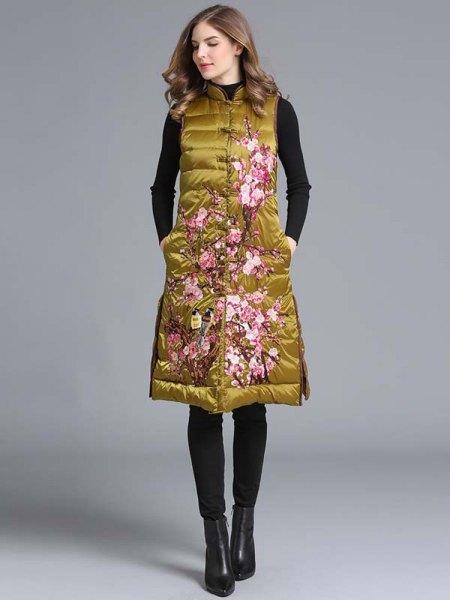 golden knee-length slim fit longline vest with black jeans
