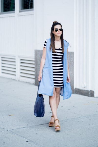 light blue longline vest with black and white striped mini dress