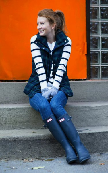 black and white striped long-sleeved sweater with dark blue checked vest