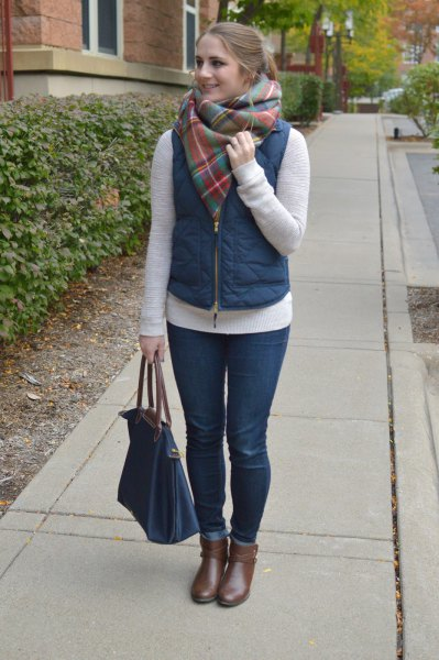 Puffer vest with gray cashmere scarf and short gray leather boots