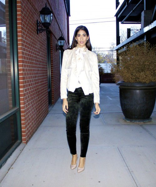 white blazer with black slim fit trousers and pointed toe heels